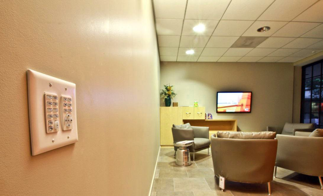Commercial Audio Visual Systems - HD Display with wall-mounted Controller installed by Gridworks